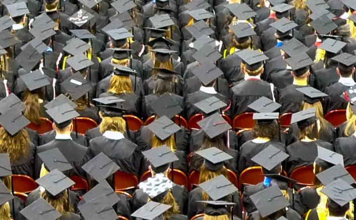 Graduation Gown Caps at Ceremony
