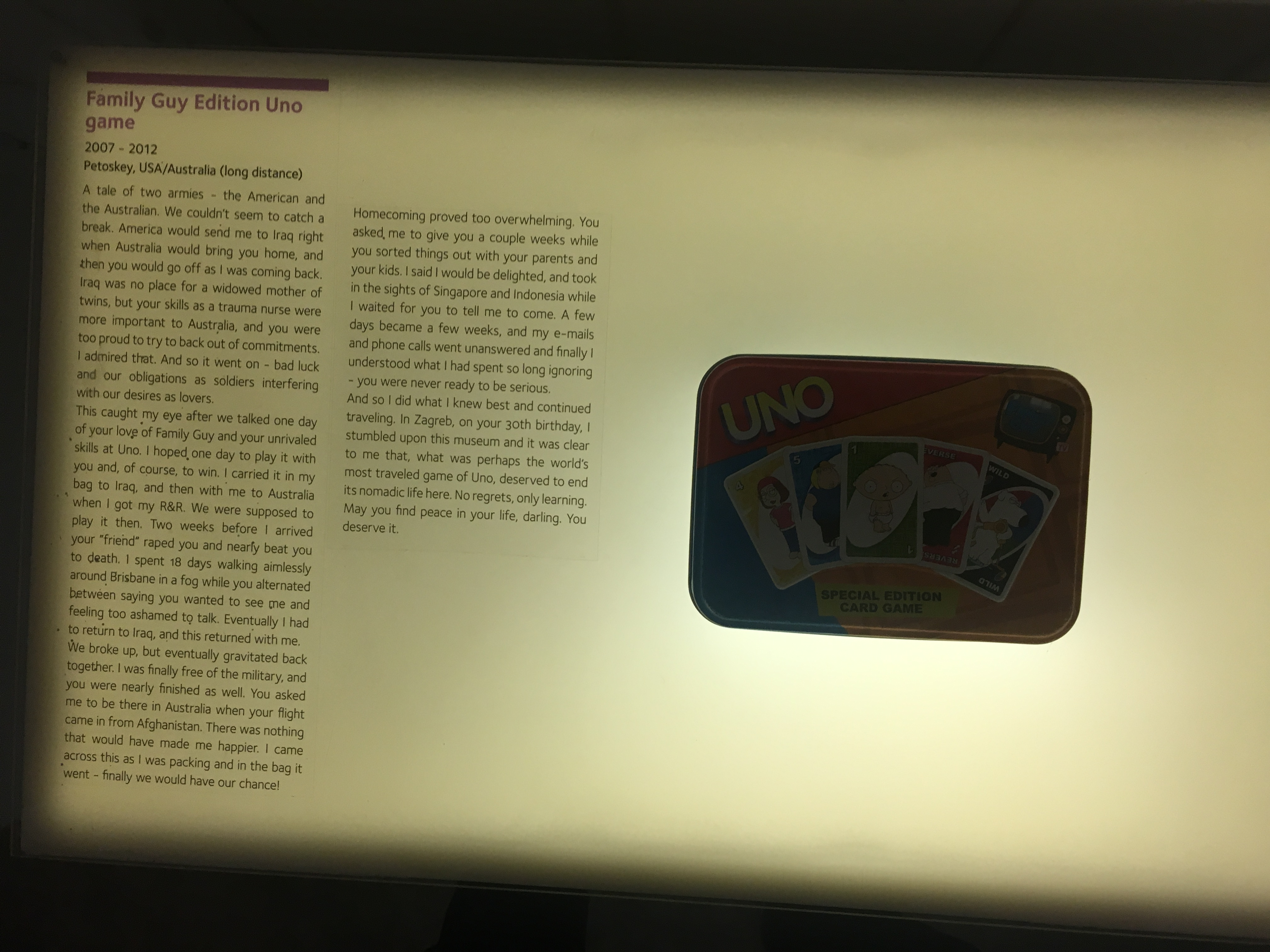 A Family Guy edition of the Uno card game, displayed alongside the love story of two soldiers. Photo by author of an exhibit in the Museum of Broken Relationships, Zagreb.